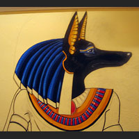i made the descision to paint anubis with his ears facing forward even though many illustrations show him with ears that face backwards i feel that this